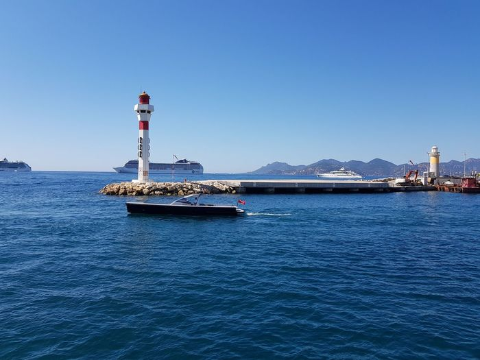 Day Water Outdoors No People Sea Transportation Tranquility Architecture Building Exterior Travel Destinations Sky Nature Clear Sky Lighthouse Nautical Vessel
