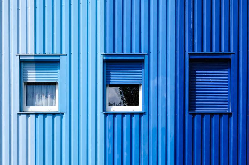 Full frame shot of blue window of building