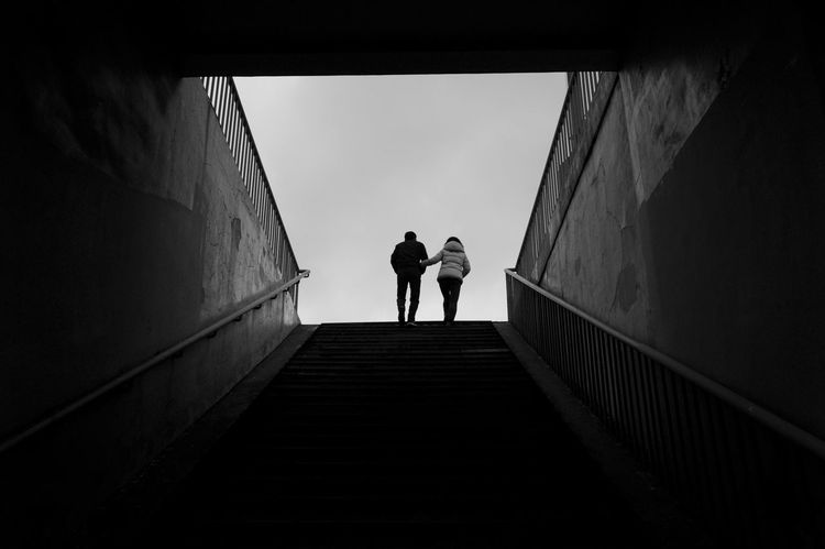 Architecture Built Structure Rear View Staircase Two People Men Walking The Way Forward Direction Full Length Lifestyles Women Real People People Adult Day Silhouette Wall - Building Feature Railing Togetherness Tunnel Steps And Staircases Outdoors Light At The End Of The Tunnel Streetphotography