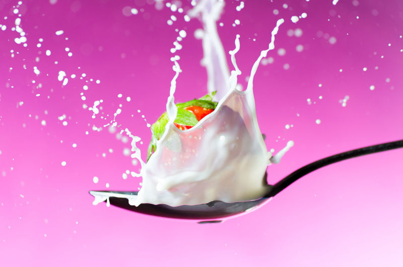 Strawberry splash Colored Background Pink Background Studio Shot High-speed Photography Strawberry Splash Milk Splash Strawberry