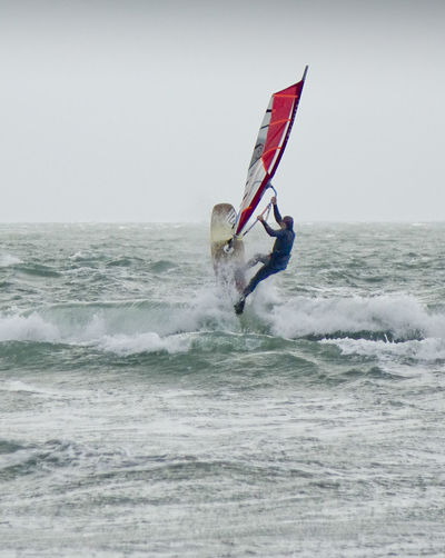 Windsurfers enjoying the extreme conditions as Storm Barbara made landfall in the UK. Coast Coastal Coastline England Europe Hampshire  Hants Hayling Island  Jump Ocean Sea Seascape Storm Storm Barbara Stormy Stormy Weather Surf Uk Wave Waves Windsurf Windsurf Life Windsurfer Windsurfers Windsurfing
