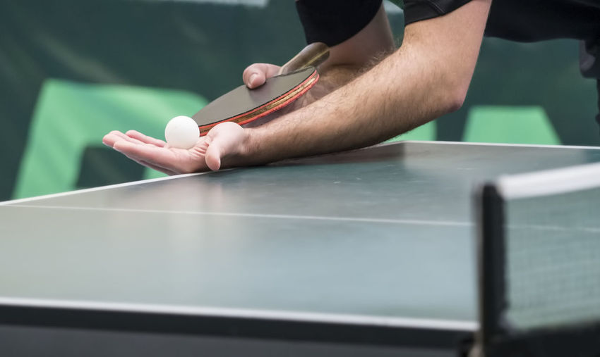 Low Section Of Person Playing Table Tennis