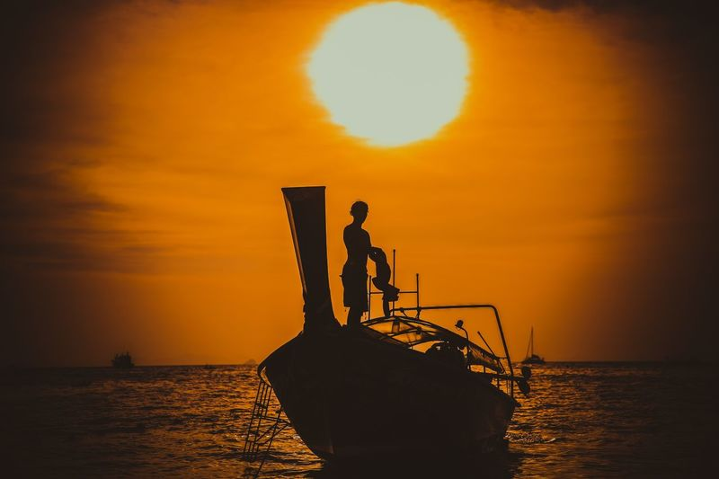 Sunset Sea Silhouette Water Horizon Over Water Nature Beauty In Nature Sky Outdoors Fisherman One Person Real People Transportation Men Lifestyles Standing Scenics Tranquility Nautical Vessel Leisure Activity