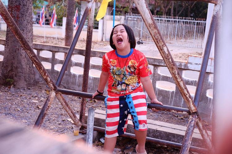 Full length of smiling girl in playground