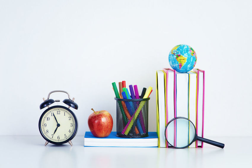 back to school - apple and books with pencils Office Alarm Clock Back To School Book Class Clock College Colored Pencil Concept Copy Space Desk Organizer Education Educational Environment Magnifying Glass Red Apple Fruit Studio Shot Study Time Textbooks White Background