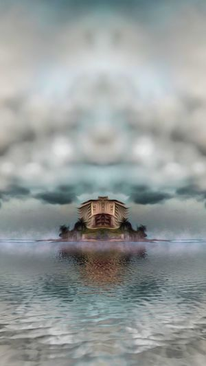 Built structure in sea against sky