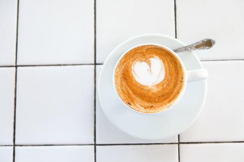 Cappuccino on tiled floor