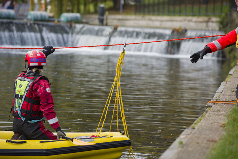 Cambridge firemen practicing river crossing Emergency Practice Rope Services Adult Boat Cambridge Crossing Day Firefighters Firemen Hardhat  Headwear Helmet Men Nautical Vessel Oar One Person Outdoors People Real People Reflective Clothing River Transportation Water
