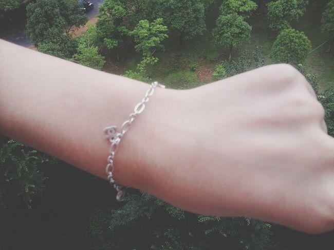 The bracelet is the birthday present which her boyfriend gave her. She likes her boyfriend very much.@ Humansofzjut
