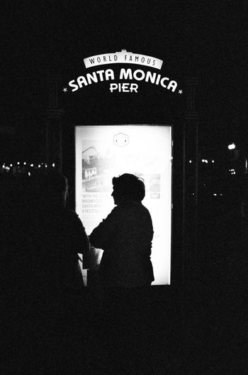 Santa Monica by Night 35mm Film Film Is Not Dead Black And White Photography Street Photography Streetphoto_bw Views From The Sidewalk Black And White Film Photography Film Camera Fujifilm Signs
