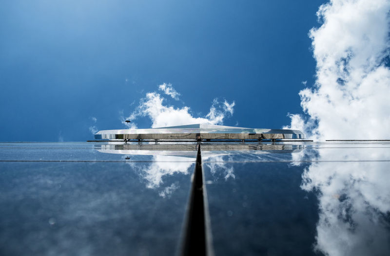 Glass Building With Reflection Of Clouds And Sky On It