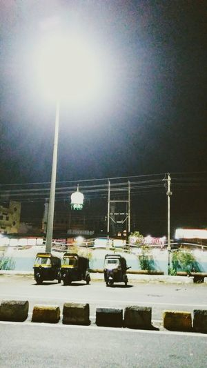 Night Illuminated Outdoors Transportation Sky Black Background Black Out And About Autos Auto Stand Street Scenics Streetphotography Street Light Streetlights Illuminance Illmination Underthestreetlight Railwaystation Outside Photography Outside A Railway Station