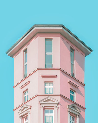 Pastel Power Apartment Architecture Blue Building Building Exterior Built Structure City Clear Sky Copy Space Day Glass - Material Low Angle View Nature No People Outdoors Pastel Pattern Pink Color Red Residential District Sky Window