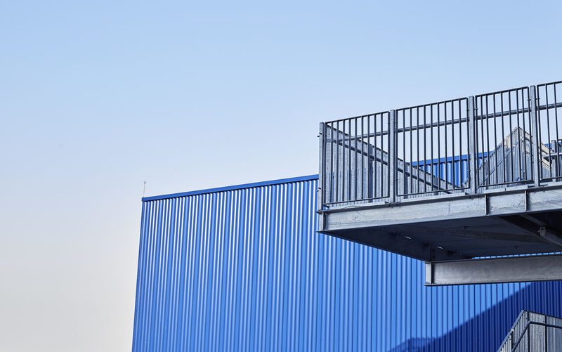 Sky Architecture Low Angle View Built Structure Clear Sky Blue Building Exterior Nature Day No People Copy Space Railing Metal Sunlight Building Outdoors Protection City Security Factory Corrugated