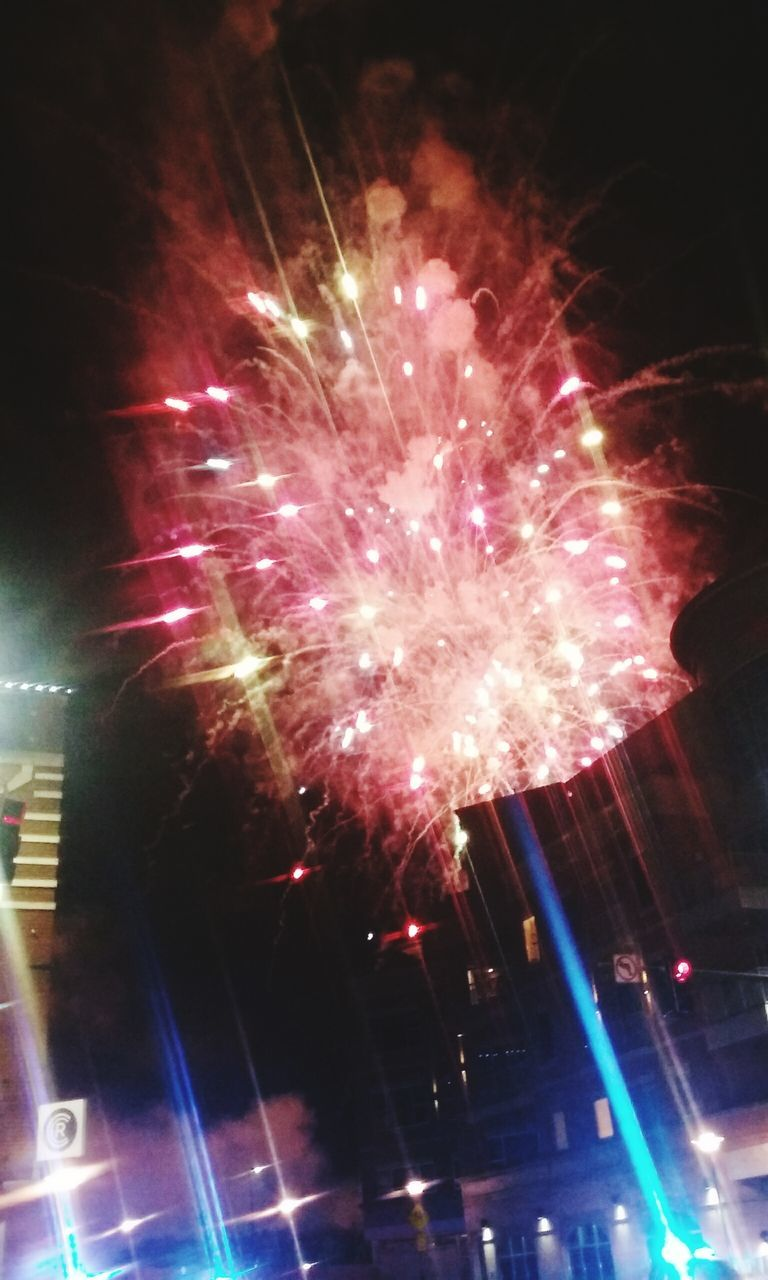 celebration, firework display, night, exploding, firework - man made object, illuminated, arts culture and entertainment, long exposure, sparks, low angle view, glowing, multi colored, event, firework, no people, blurred motion, motion, sky, outdoors, sparkler