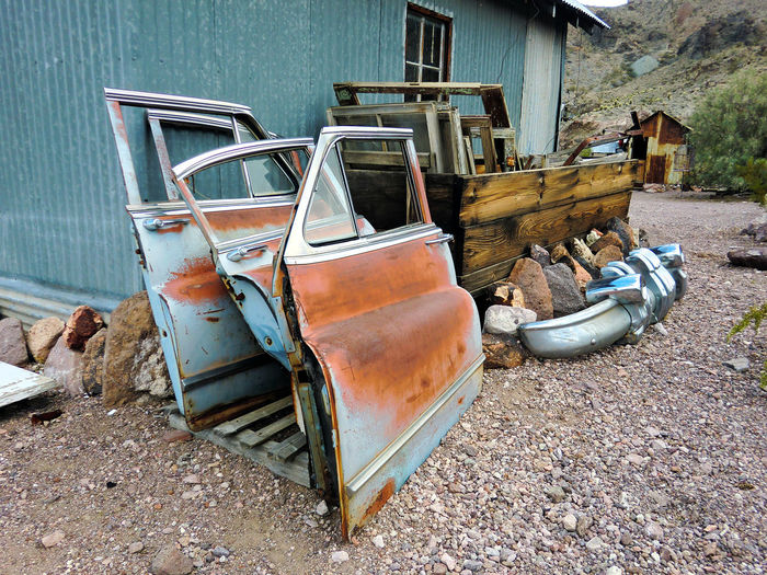 Abandoned boat against the wall