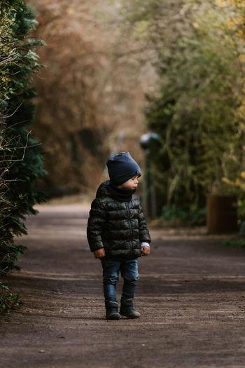 Full length of boy walking on footpath