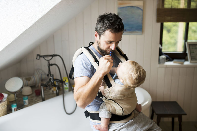 Man with baby sitting at home