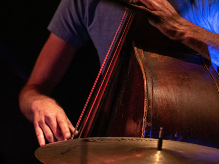 Concert Photography: Jazz Instruments: Double Bass and Cymbal Real People Midsection One Person Music Indoors  Men Musical Instrument Musical Equipment Arts Culture And Entertainment Playing Skill  Human Hand Holding Hand Standing Human Body Part Musician Occupation Wood - Material Double Bass Cymbal