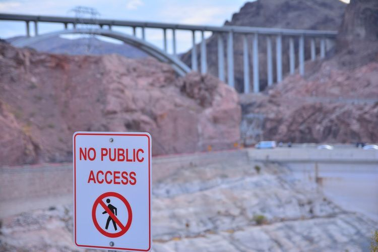 Close-up of warning sign on bridge