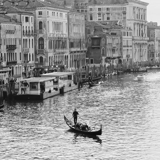 Man in boat on city