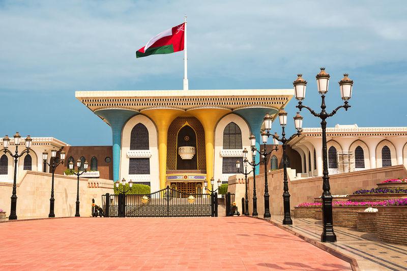 Flag on building against sky
