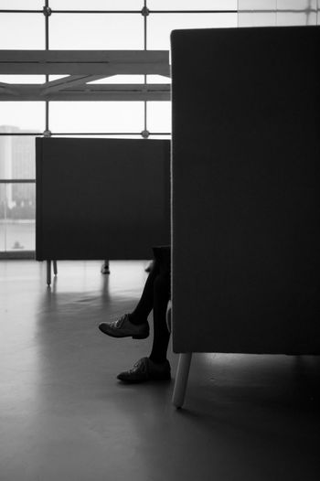 Low section of woman sitting on floor