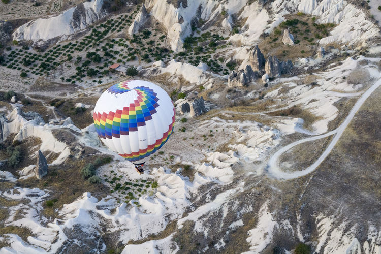 High Angle View Of Hot Air Balloon Over Rock Formations At Cappadocia