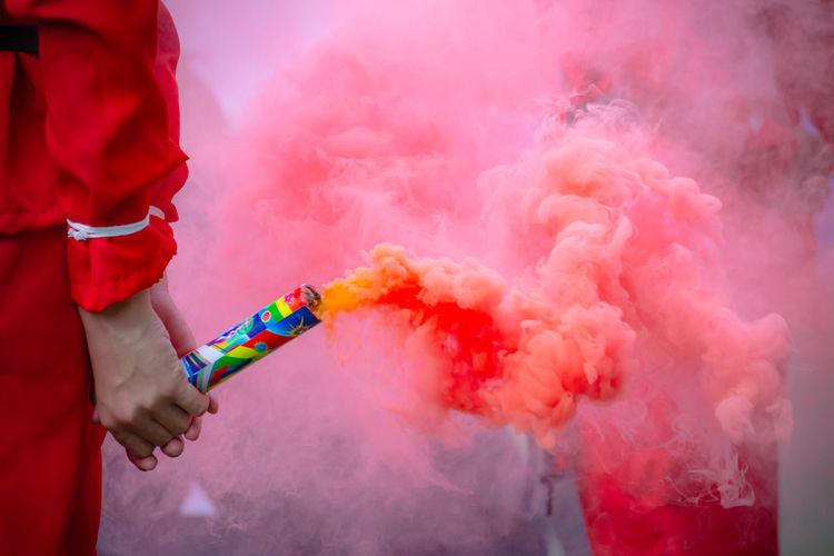 Smoke - Physical Structure Multi Colored One Person Red Celebration Motion Human Body Part Studio Shot Clothing Holding Unrecognizable Person Outdoors Activity Enjoyment Day Men Human Hand Human Limb Festival Obscured Face