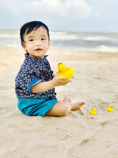 Boy is playing sand on the beach. People Boys Sky Smile Sandbeach Sand Kids Duck Land Beach One Person Real People Baby Water Young Child Cute Sea Nature Outdoors Sitting Lifestyles