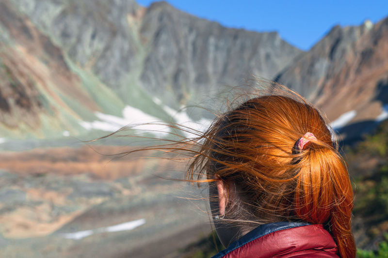 Mountain One Person Real People Women Leisure Activity Redhead Lifestyles Focus On Foreground Adult Nature Hairstyle Beauty In Nature Day Mountain Range Hair Human Hair Outdoors Environment Long Hair Mountain Peak