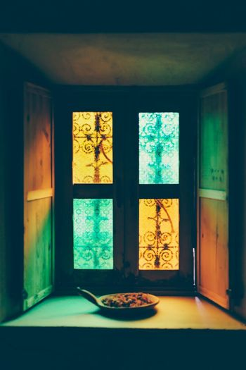 Window Indoors  Transparent Glass - Material Glass Sunlight Colors Ornaments Blue Sky Orange Color Shadows & Lights Colorful Shadows Warm Atmosphere