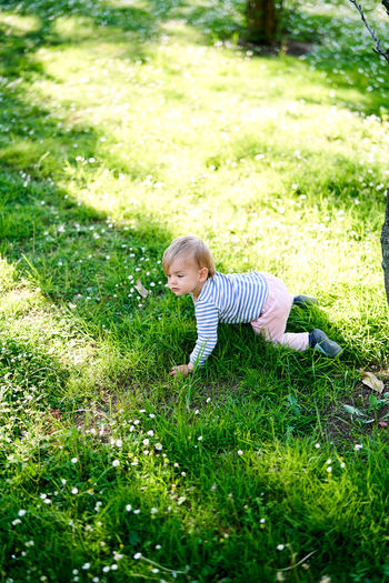 Boy standing by plants