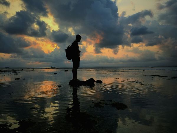 Off the horizon Silhouette Full Length Reflection Tranquility Standing Beach Water Sky Outdoors Cloud - Sky Lost In The Landscape