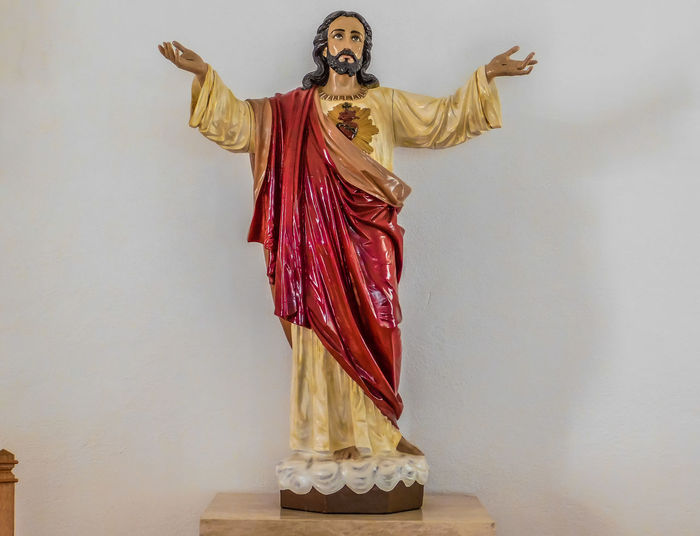 San Lorenzo, Catholic Church, Clint Texas. Saint Lorenzo is the Patron Saint of Cooks Indoors  Belief Religion Spirituality Art And Craft Human Representation One Person Representation Wall - Building Feature Sculpture Statue Clothing Studio Shot Standing Front View Copy Space Human Arm