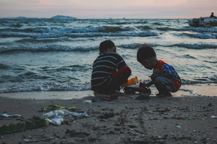 Sea Beach Child Boys Two People Togetherness Wave Garbage Pollution Decay