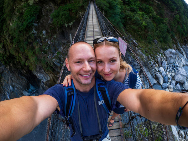 Taroko Gorge National Park, Taiwan Adult Adventure Bonding Camera Couple - Relationship Emotion Happiness Leisure Activity Lifestyles Looking At Camera Men Outdoors Photography Themes Portrait Positive Emotion Self Portrait Photography Selfie Smiling Technology Togetherness Two People Wireless Technology Young Adult