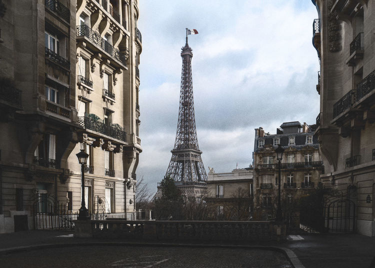 Eiffel Tower Fance Love Paris Shadows & Lights Sunrays Architecture Building Exterior Built Structure City Day Eiffeltower Flag History Monument No People Outdoors Shadow Sky Tourism Tower Travel Destinations
