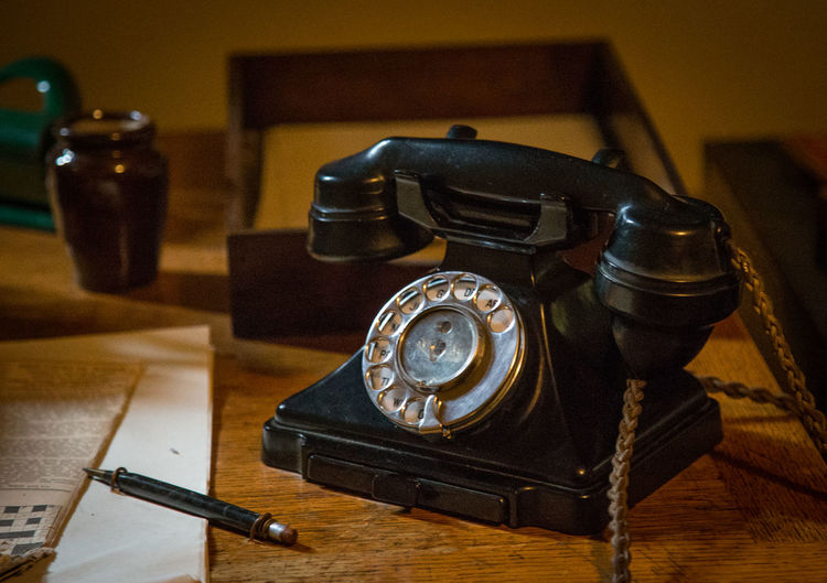 Close-up of telephone on table at home