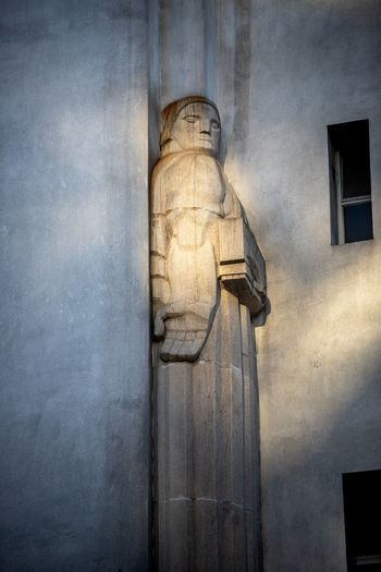 Low angle view of statue against building