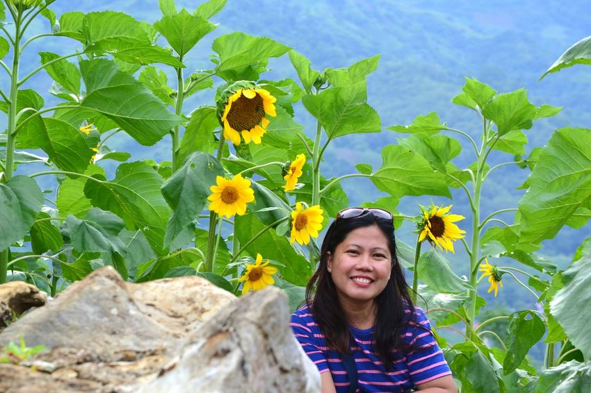 A smile will brighten a gloomy dayEyeEm Selects One Woman Only Smiling Enjoyment Happiness Portrait Its More Fun In The PHILIPPINES! CebuPhilippines EyeEmNewHere The Great Outdoors - 2017 EyeEm Awards Sirao Garden Sirao Flower Farm Live For The Story Travel Destinations