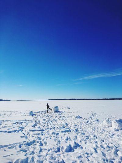 Man on snowcapped mountain against clear blue sky