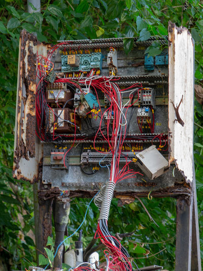 Chaotic open rusty wiring box Electricity  Messy Wire Abandoned Electrical Component Cable Power Supply Connection Box Dangerous Chaotic Fuse Box Technology Safety Rusty