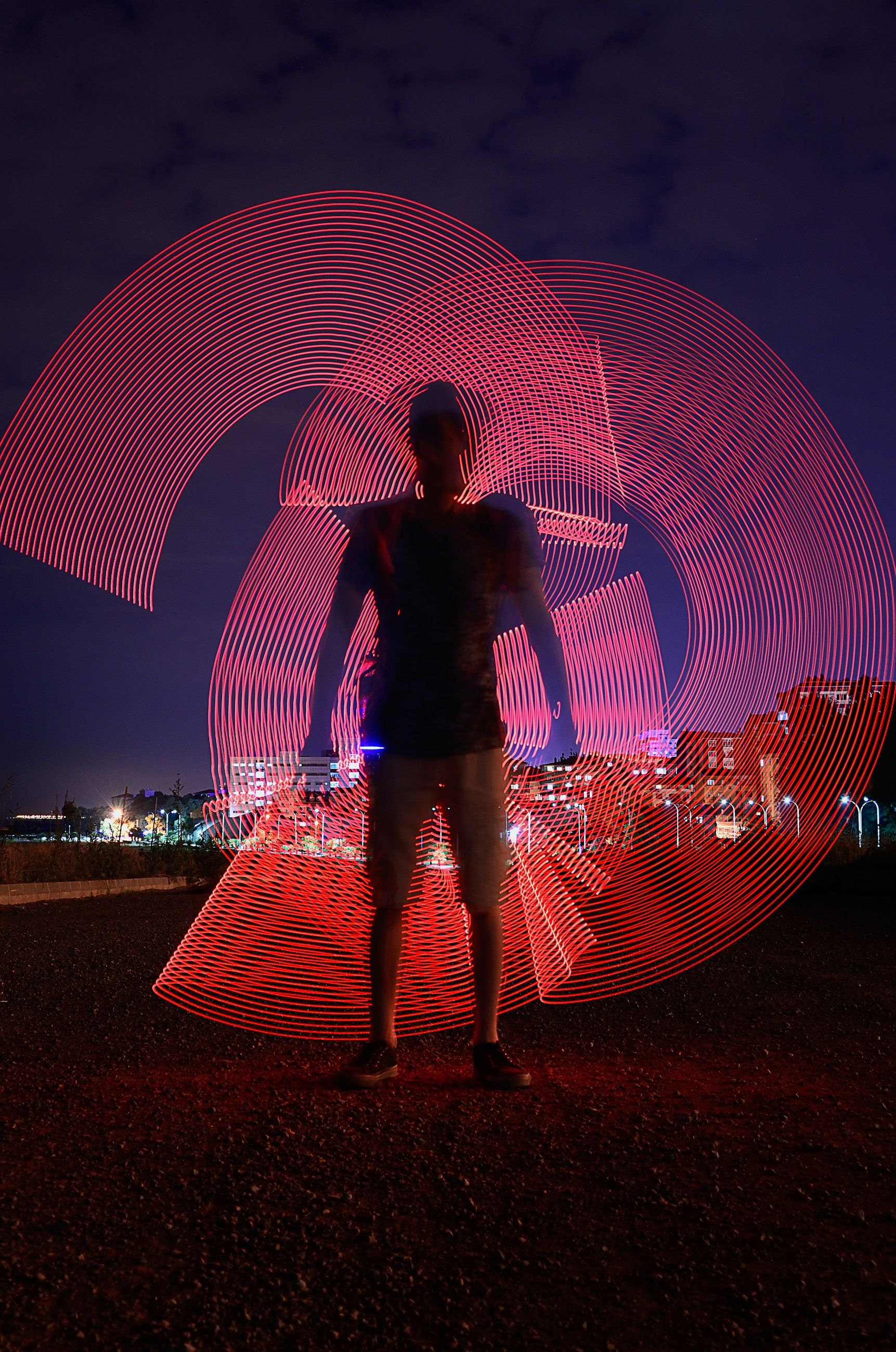 one person, real people, full length, lifestyles, standing, umbrella, leisure activity, men, illuminated, night, motion, rear view, nature, red, sky, long exposure, blurred motion, land, outdoors