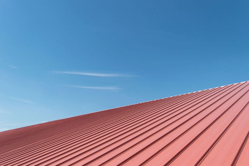 Architecture Blue Building Building Exterior Built Structure Clear Sky Copy Space Day Low Angle View Nature No People Orange Color Outdoors Pattern Red Roof Roof Tile Sky Striped Sunlight