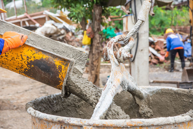 Construction Foundation Industrial Industry Liquid Ready Textured  Work Workers Backgrounds Builder Cement Concrete Equipment Floor Mixed Mixing Plasterer Pour Project Reinforcement Safety Site Structure Wet