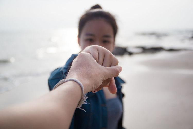 Water Beach Sea Land One Person Human Hand Portrait Hand Headshot Human Body Part Leisure Activity Day Emotion Sand Shake Hands Moments Of Happiness #NotYourCliche Love Letter My Best Photo International Women's Day 2019 Moms & Dads