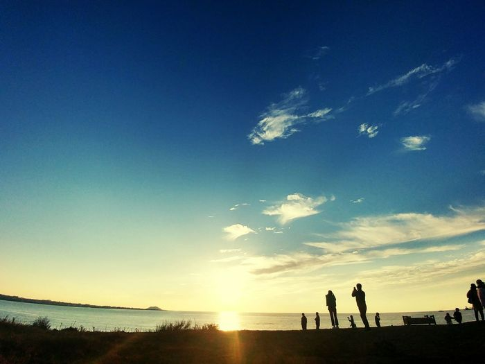 Beach Sunset Silhouette Sky People Water Tranquil Scene Summer Beauty In Nature Horizon Sand Horizon Over Water Scenics Lifestyles Standing Togetherness Nature Outdoors Vacations Sea
