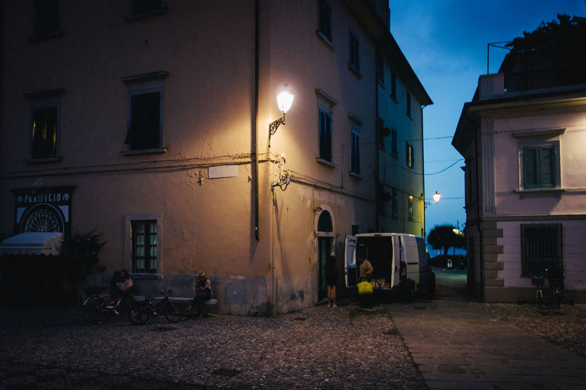 Architecture Building Building Exterior City Dusk House Illuminated Lighting Equipment Night Outdoors Real People Residential District Sky Street Street Light Street Photography Streetphotography Transportation