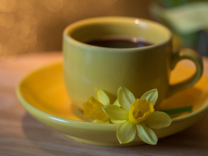 cup of coffee Coffee Food And Drink Olympus StillLifePhotography Close-up Coffee Cup Day Drink Drinking Edithnerophotography Flower Food And Drink Food Photography Indoor Photography Indoors  Indoors  Kitchen No People Refreshment Table Warm Drink Yellow Cucumber Yellow Flower In Kitchen